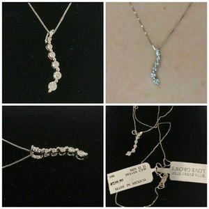 Jewelry - 10K White Gold 1/6 CTTW Diamond Journey Pendant